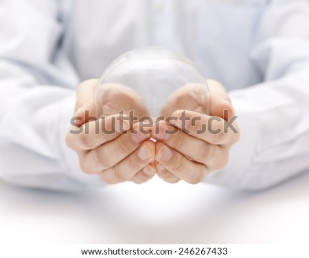 Crystal ball in hands - stock photo