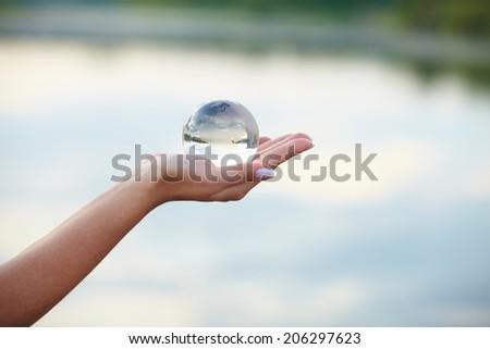 Crystal ball on hand - stock photo