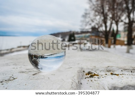 Crystal ball on the railing of the embankment of the Volga River in the city of Cheboksary. - stock photo