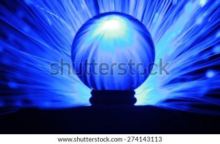 crystal ball with effect lighting - stock photo