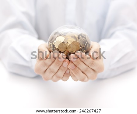 Crystal ball with money in hands - stock photo