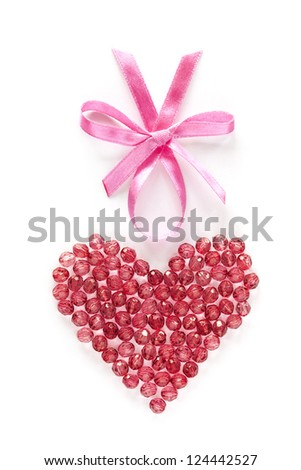 Crystal Beads Heart for Valentine's or Wedding Day with pink bow. Isolated on white background. - stock photo