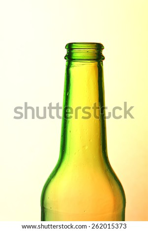 Crystal bottle against a bright and colorful background - stock photo