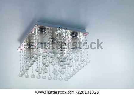 Crystal chandelier on ceiling - stock photo
