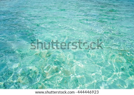 Crystal clear blue water in tropical lagoon for texture or background - stock photo