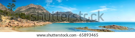 Crystal clear turquoise waters at Coles Bay, located in the Freycinet region on Tasmania's east coast. A popular Australian tourist destination. - stock photo