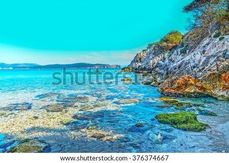 crystal clear water in Cala Dragunara, Sardinia - stock photo