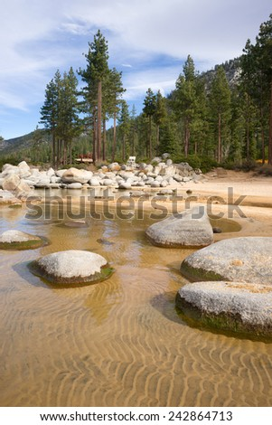 Crystal Clear Water Smooth Rocks Lake Tahoe Sand Harbor - stock photo