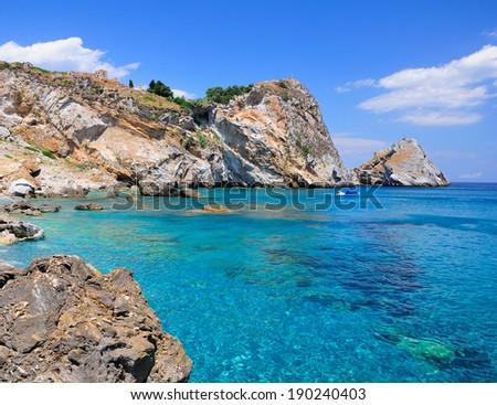 Crystal clear waters of Kastro beach, Skiathos island, Sporades archipelago, Greece - stock photo