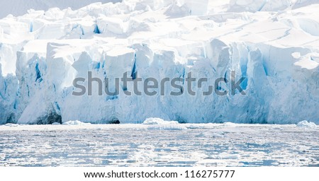 Crystal glacier in the  Antarctic waters - stock photo