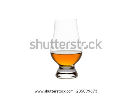 Crystal glass containing whiskey, bourbon, or other amber liquor.  Isolated on white. - stock photo
