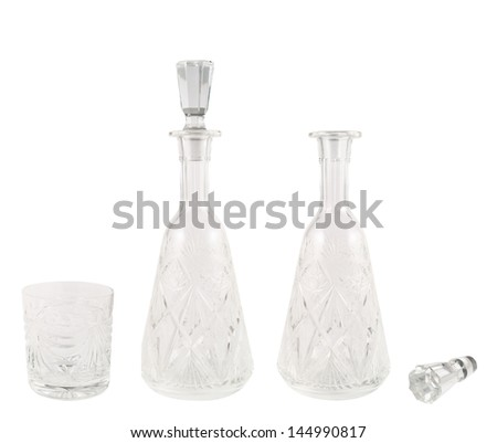 Crystal glass tumbler and decanter vessel composition isolated over white background - stock photo