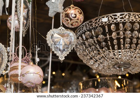 Crystal heart pendant and a basket with Christmas balls, old pink, Czech republic - stock photo