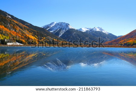 Crystal lake in the middle of San Juan mountains - stock photo