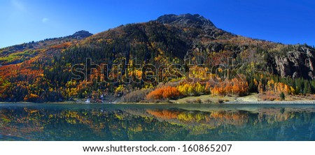Crystal lake reflections in Colorado - stock photo