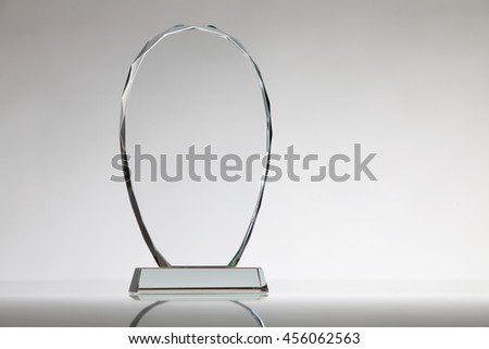 crystal or glass trophy on the white background - stock photo