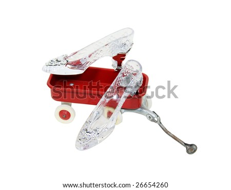 Crystal Slipper representing fashion and cinderella-like fantasies in a little red wagon-Path orig size - stock photo