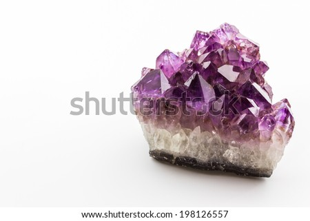 Crystal Stone, purple rough amethyst crystals on white background. - stock photo