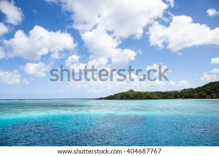 Crystal turquoise blue sea in a tropical beach on sunny day. Transparent sea water. Sunny day sea background. - stock photo