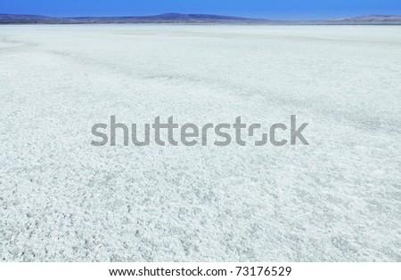 Crystallized salt in lake - stock photo