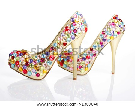 Crystals Encrusted Golden Shoes on a white background - stock photo