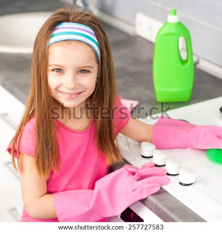 ctte girl make cleaning in the kitchen at home - stock photo