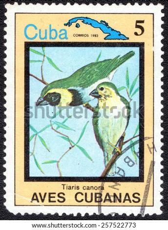 "CUBA - CIRCA 1983:A postage stamp shows Tiaris canora, from series ""Cuban Birds"", circa 1983 - stock photo"
