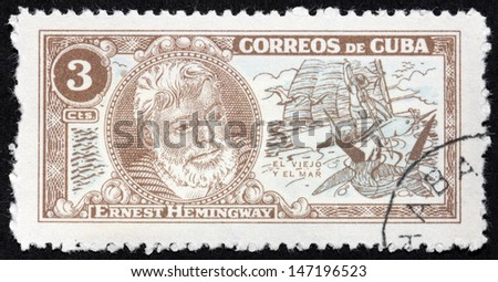 "CUBA - CIRCA 1963: A stamp printed by CUBA shows image portrait of Nobel Prize-winner for Literature famous American writer Ernest Hemingway (1899-1961), ""The Old Man and The Sea"", circa 1963 - stock photo"