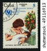 CUBA - CIRCA 1987: A  stamp printed by Cuba,  shows Mother with the baby. UN Child Survival Campaign, circa 1987. - stock photo
