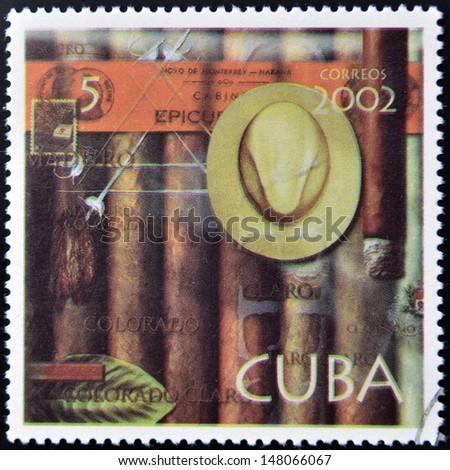 CUBA - CIRCA 2002: A stamp printed in Cuba dedicated to Havana cigars, circa 2002 - stock photo
