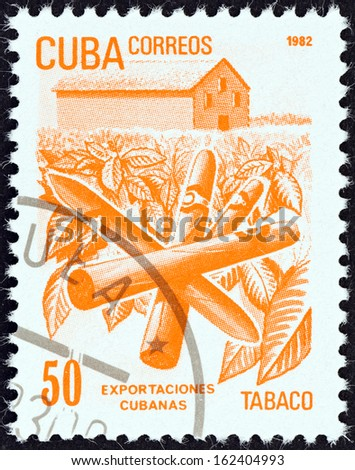 """CUBA - CIRCA 1982: A stamp printed in Cuba from the """"Exports"""" issue shows cigars (tobacco), circa 1982.  - stock photo"""