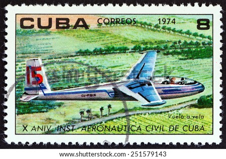 """CUBA - CIRCA 1974: A stamp printed in Cuba from the """"The 10th Anniversary of The Civil Aeronautical Institute """" issue shows Glider in flight, circa 1974.  - stock photo"""
