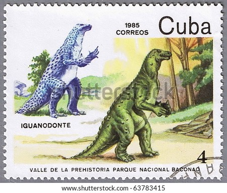 CUBA - CIRCA 1985: A stamp printed in Cuba shows Iguanodontus, series devoted to prehistoric animals, circa 1985 - stock photo