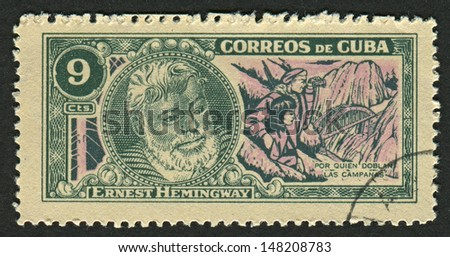 CUBA - CIRCA 1963: A stamp printed in Cuba shows image of the Ernest Miller Hemingway (July 21, 1899 - July 2, 1961) was an American author and journalist, circa 1963. - stock photo