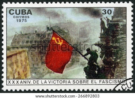 CUBA - CIRCA 1975: A stamp printed in Cuba shows Raising red flag over Reichstag, Berlin, 30th anniversary of the the Victory Over Fascism, circa 1975 - stock photo