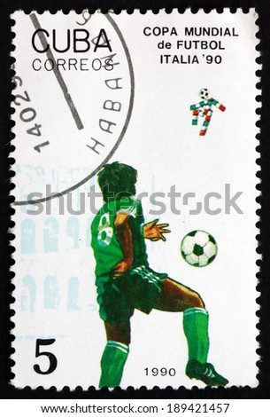 CUBA - CIRCA 1990: a stamp printed in the Cuba shows Soccer Players in Action, 1990 World Cup Soccer Championships, Italy, circa 1990 - stock photo