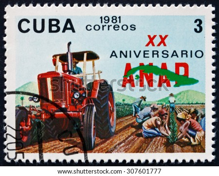 CUBA - CIRCA 1981: a stamp printed in the Cuba shows Tractor and Workers, National Association of Small Farmers, circa 1981 - stock photo