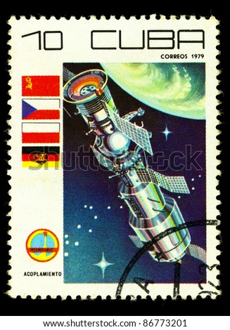 CUBA - CIRCA 1979: A vintage postal stamp printed in Cuba with a postmark dated 1904, depicting a space satellite named Acoplamiento in orbit circa 1979 - stock photo