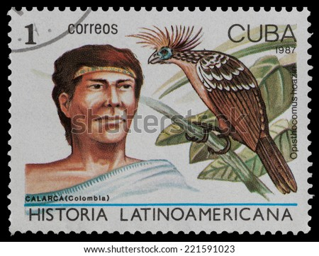 CUBA - CIRCA 1987: The postal stamp printed in CUBA shows calarca (Colombia) and opisthocomus hoazin, circa 1987 - stock photo
