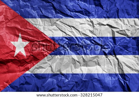 Cuba flag painted on crumpled paper background - stock photo