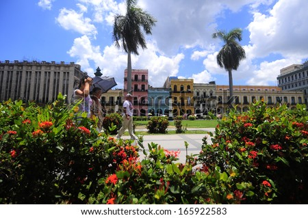 CUBA, HAVANA - JUNE 28: Hot day on the square in front of National Capitol Building in Old Havana. El Capitolio was the seat of government in Cuba until after the Cuban Revolution in 1959 - stock photo