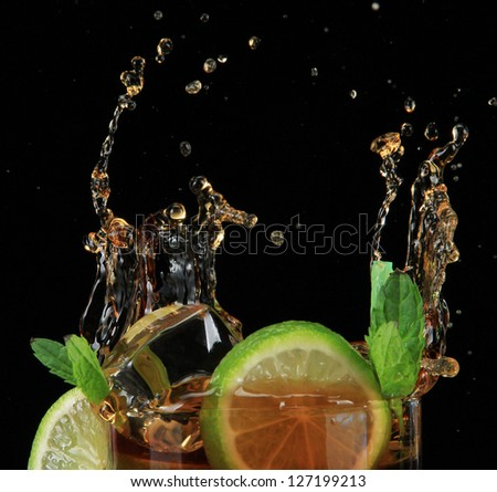 Cuba libre cocktail on black background - stock photo