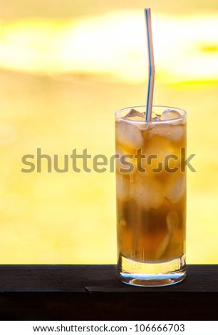 Cuba libre cocktail to background the bright sunlight - stock photo