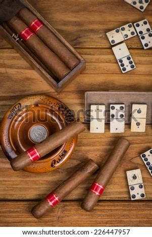 Cuban cigars and traditional domino game - stock photo