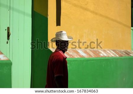 Cuban man on the beach - stock photo