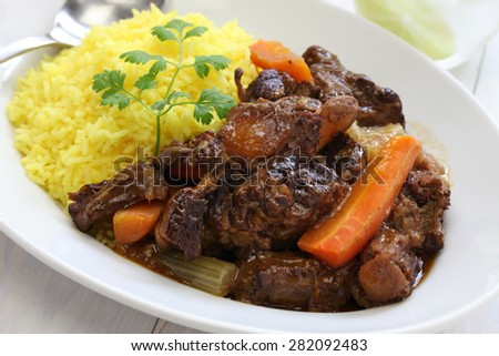 cuban oxtail stew with yellow rice, rabo encendido - stock photo