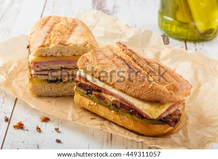 Cubanito. Traditional Cuban Sandwich with Ham, Pork and Cheese - stock photo