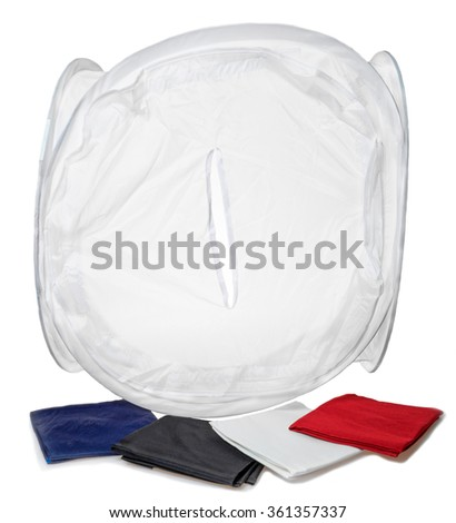 Cube Light Tent with colored Backdrops. Photo studio shooting - stock photo