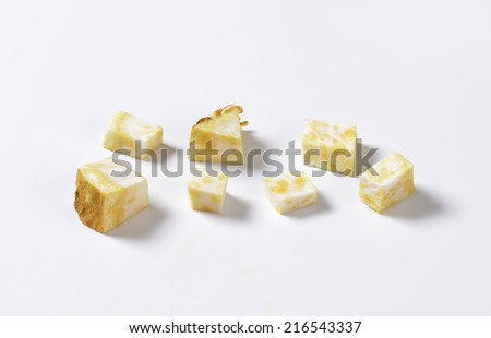 cubed celery on white background - stock photo