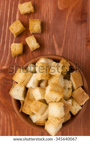 Cubes of bread croutons of white bread for cream soups. - stock photo